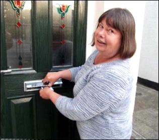 Sue Atkins on doorstep, photo by TUSC
