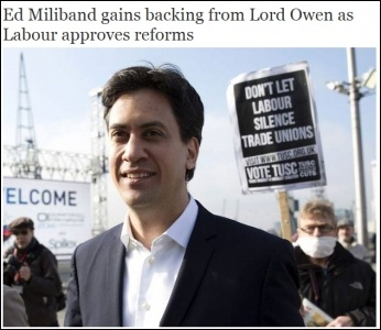 Photo of TUSC protester behind Miliband used by the Independent