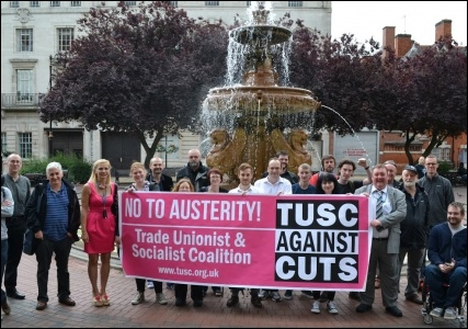 Councillors Barbara Potter and Wayne Naylor stand with the TUSC banner alongside Leicester TUSC supporters
